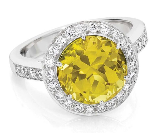 Sunrise - large yellow sapphire fine diamond halo ring