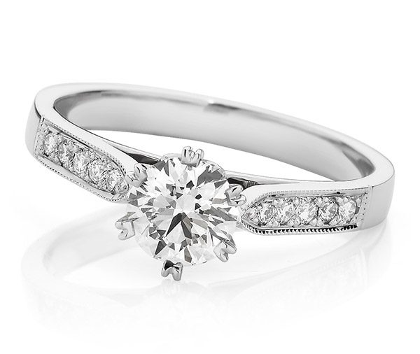 Vintage style solitaire diamond engagement ring with a round brilliant cut diamond set in a six split claw setting