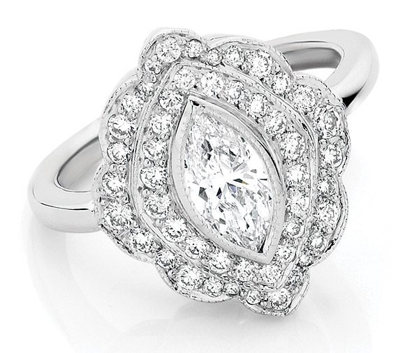 engagement ring of marquise cut diamond with a double row of grain set diamonds enhanced by millegraine detailing