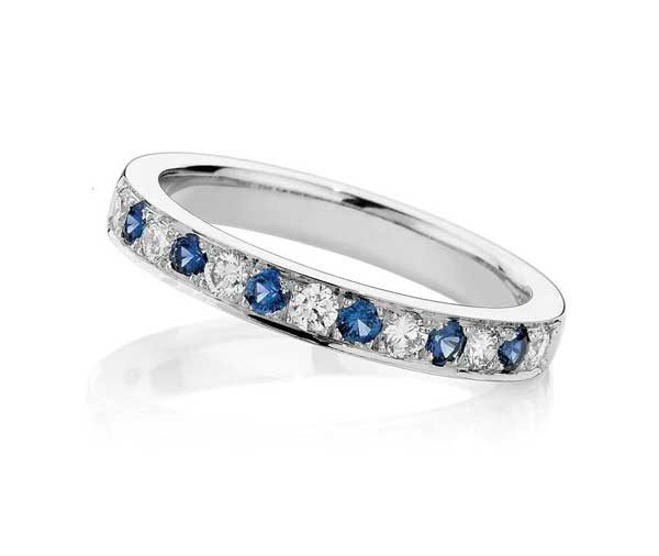half circle of grain set alternating round brilliant cut diamonds and ceylon sapphires