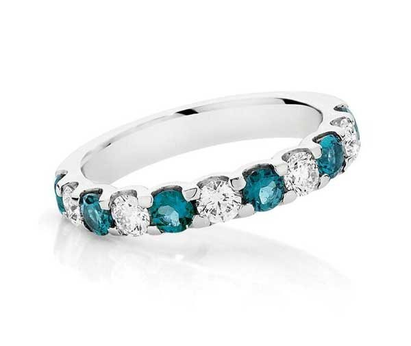 Half circle shared claw band of teal blue tourmalines alternating with round brilliant cut diamonds in white gold