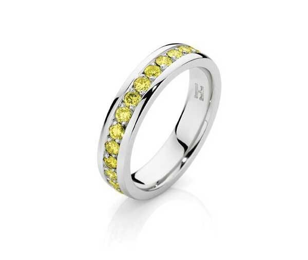 half circle of channel set round yellow diamonds in 18ct white gold