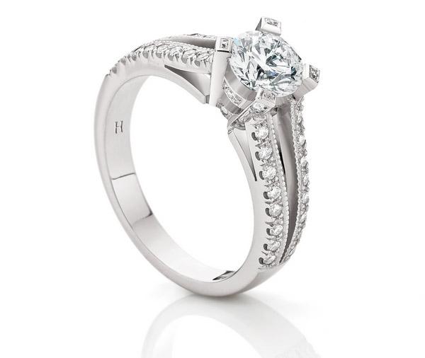Serenity: Round Brilliant Cut Diamond set in four diamond set claws