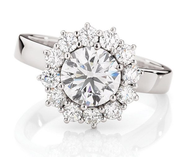 single larger round brilliant cut Diamond claw set in the centre