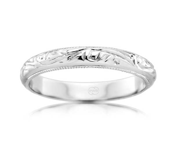 Half rounded white gold band with engraved pattern and millegrained edges