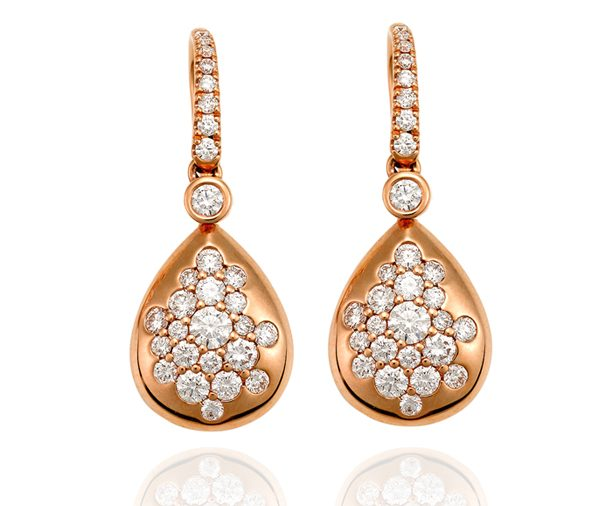 rose gold droplet shaped earrings speckled with assorted sizes of round brilliant diamonds